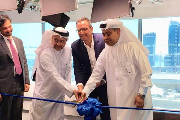 QFC CEO, Minister of Commerce and Industry, and Bloomberg ME cutting the ribbon to launch the first Bloomberg studio in Qatar