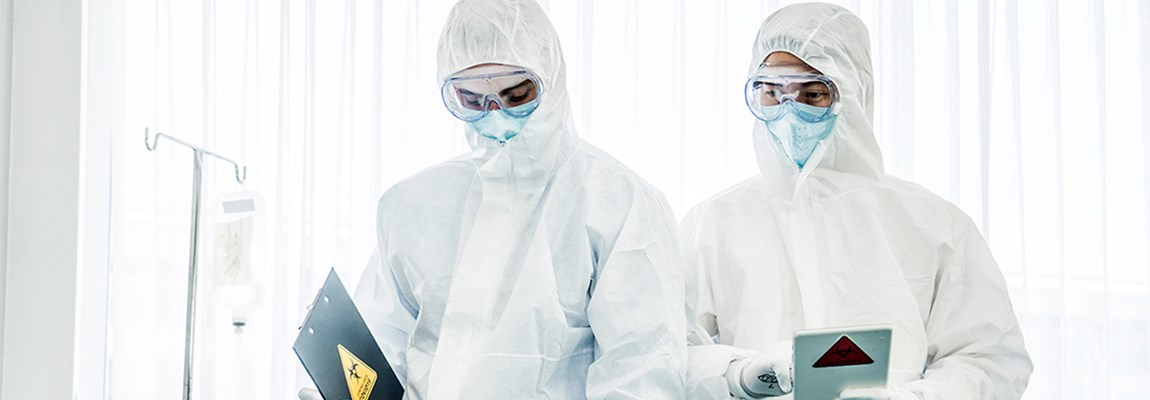 Doctors standing in protective white suite